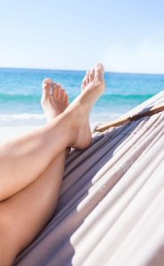 42216317 xl 185x300 - 42216317 - woman relaxing in the hammock at the beach